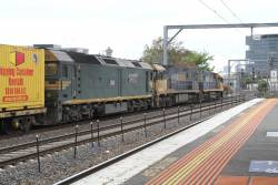 NR101 leads NR82 and G538 on AM5 on the up at Middle Footscray