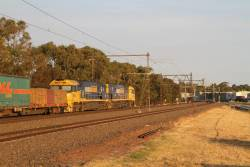 NR104 leads NR41 on 2PM5 up freight at Altona Junction