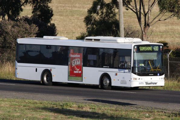 Plain white liveried Westrans bus #108 6039AO on a route 400 service at Deer Park