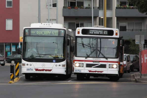 Pair of Westrans buses on route 410 pass at Footscray - low floor 6087AO and high floor bus #33 4927AO on route