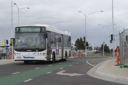 Westrans bus #112 rego 7362AO on route 448, crossing the RRL tracks at Wyndham Vale