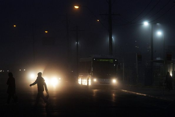 Bus in the fog outside Footscray station