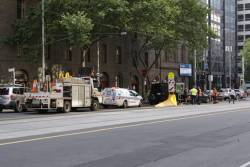 Police and Yarra Trams staff in attendance at a car crash on William Street