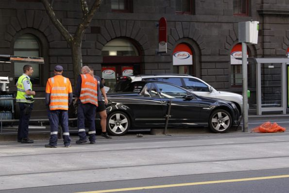 Car crash on William Street at Bourke Street, the safety zone fence destroyed