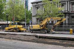 Bulldozer and excavator parked outside Flagstaff station