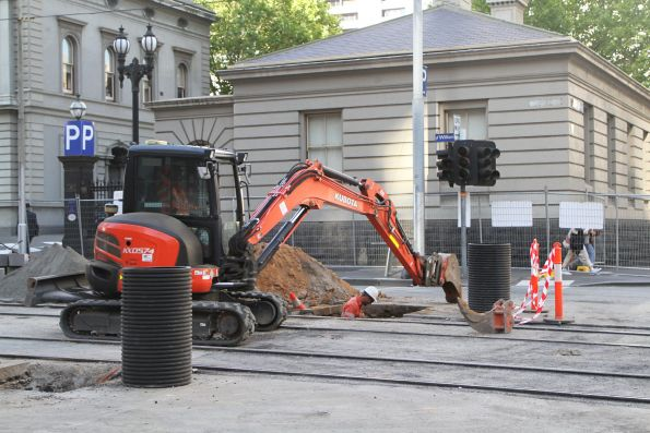 Excavating beside the tram tracks at William and Little Lonsdale Street