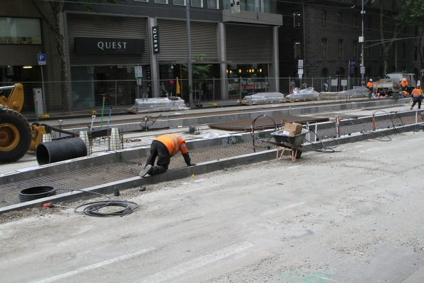 Laying rebar for the new platform stop at William and Bourke Street