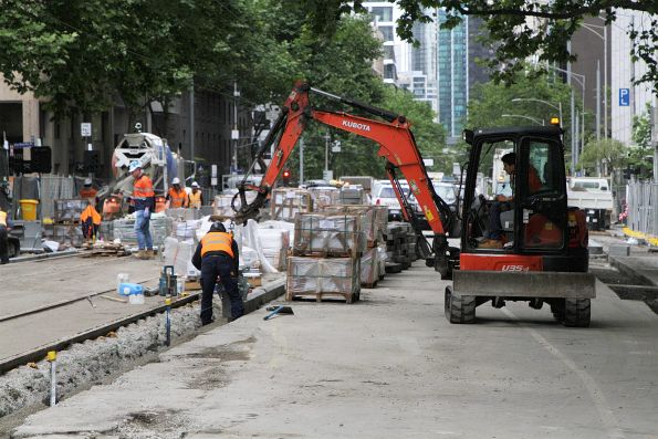 Installing bluestone kerbing south of Lonsdale Street