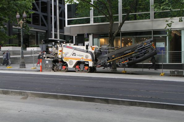 New track complete with asphalt surface and bluestone kerbing at William and Little Collins Street
