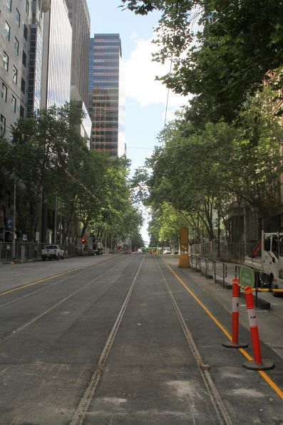 New track in place with original overhead wire north of William and Collins Street