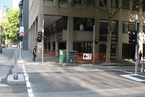 Pedestrian crossing partially closed at the corner of William and Little Bourke Street