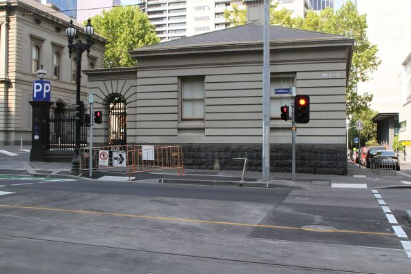 Pedestrian crossing partially closed at the corner of William and Little Lonsdale Street