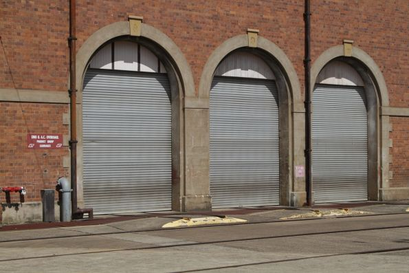Steel roller doors retrofitted to the brick workshop buildings