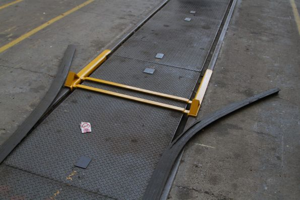 Rubber gap filling strips cover rail flangeways in the public area