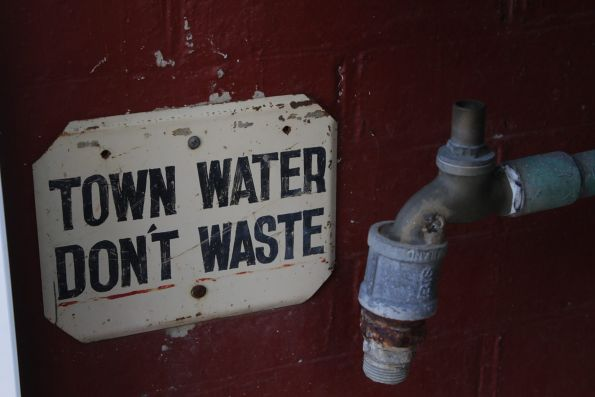 'Town Water - Don't Waste' sign beside a tap
