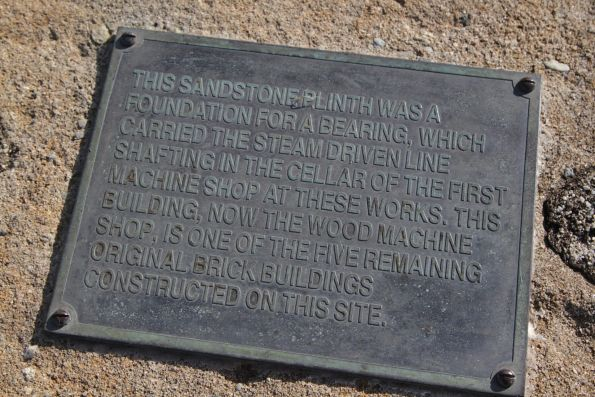 Plaque on a sandstone plinth, previous used to hold the steam driven line shafting