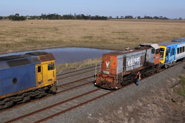 G527 and A73 lead the northbound Mildura freight past Y168 and the X'Trapolis transfer