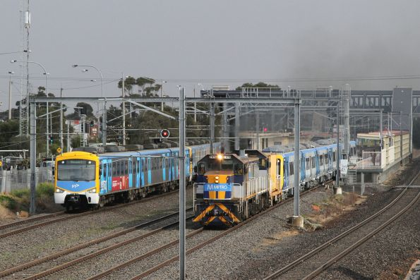 T373 and T376 leads a new X'Trapolis train through Laverton station