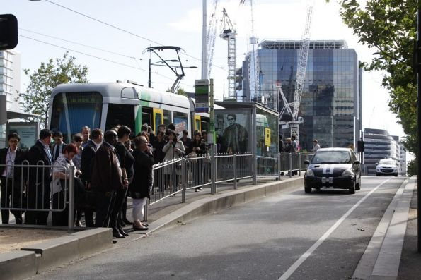 Packed C class tram drops off Docklands workers at Southern Cross Station