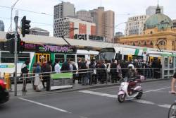 Queue at Federation Square to board trams southbound along St Kilda Road