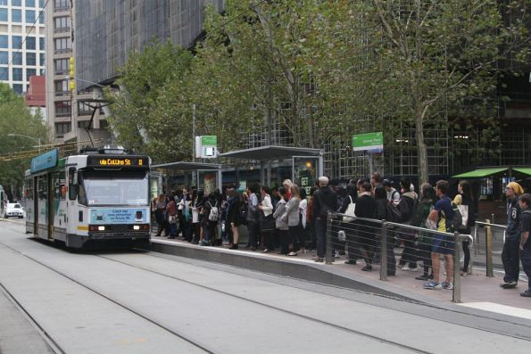 A1.250 on route 11 arrives at a packed tram stop at Collins and Spencer Streets