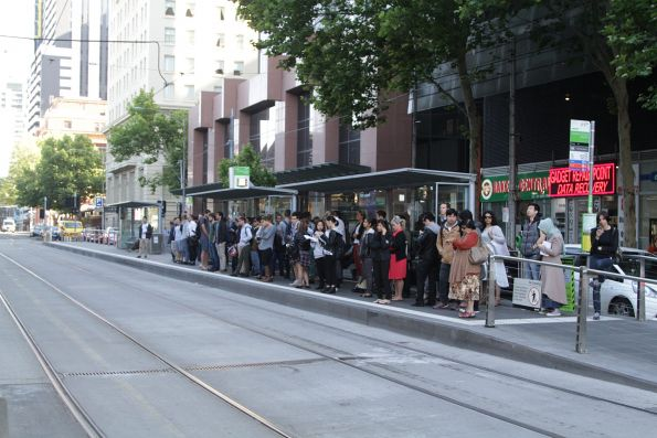 Crowd of passengers waiting for a southbound route 96 service outside Southern Cross Station