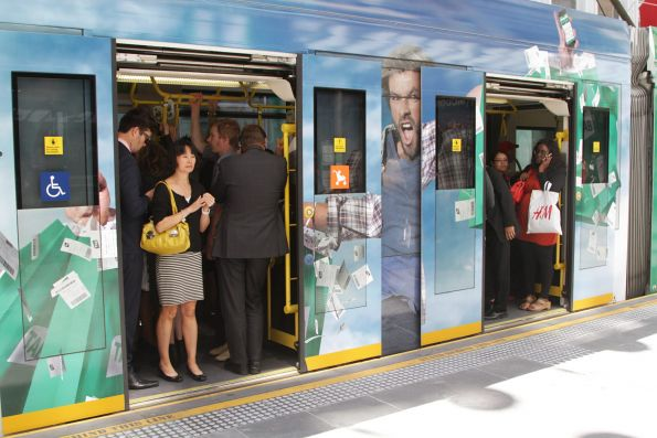 Westbound route 96 tram packed with passengers during lunchtime in the Bourke Street Mall