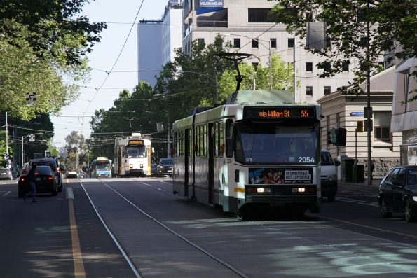 B2.2054 leads a pack of three route 55 trams on William Street