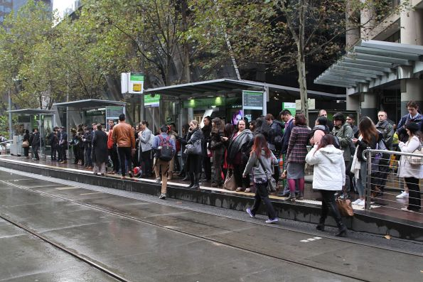 Overcrowded eastbound tram stop at Collins and Spencer Street