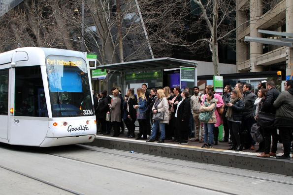 Long queue of passengers waiting for westbound trams at Collins and Spencer Street