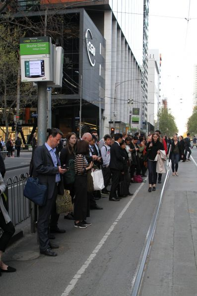 Already a big crowd at William and Bourke Street for route 58 trams