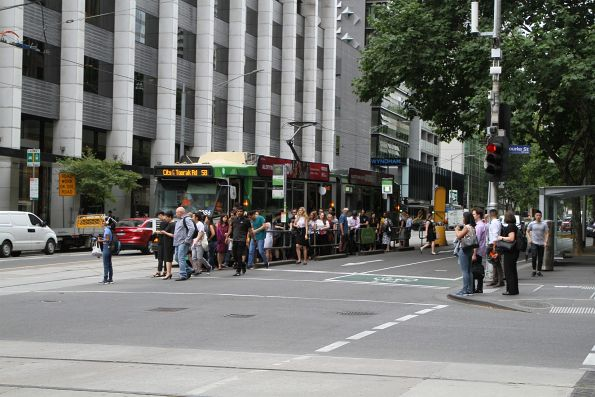 Exiting passengers overflow the 'safety zone' tram stop on route 58 at William and Bourke Street