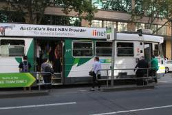 Passengers struggle to board a crowded route 58 tram at William and Lonsdale Street