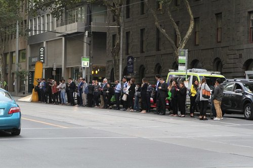 Crowd of waiting southbound route 58 passengers at William and Bourke Street