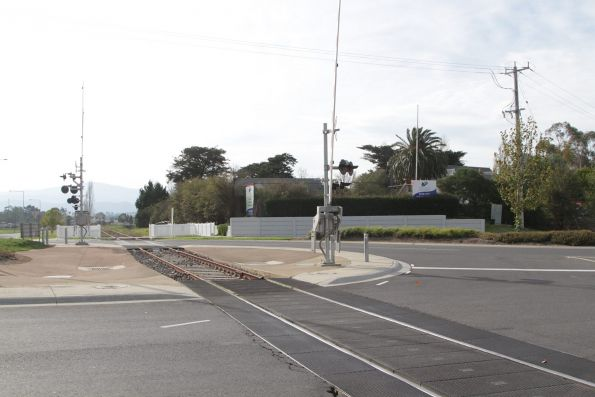 Railway passes through the middle of the Melba Highway roundabout at Yarra Glen station