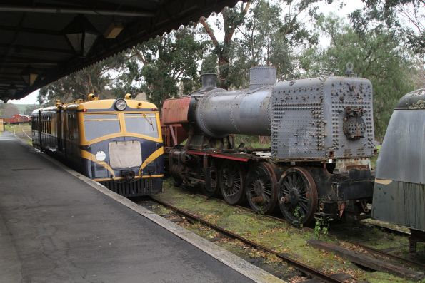 Walker railmotor RM22 alongside steam locomotive J516 under restoration at Healesville